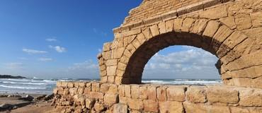 Ancient Roman aqueduct at Ceasarea along the coast of the Mediterranean Sea, Israel.